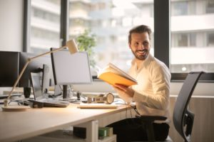 smiling man sitting at desk
